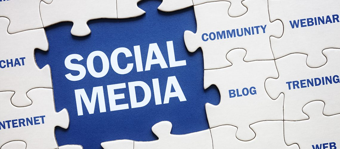 Social media concept jigsaw piece reading marketing, networking, community, internet etc